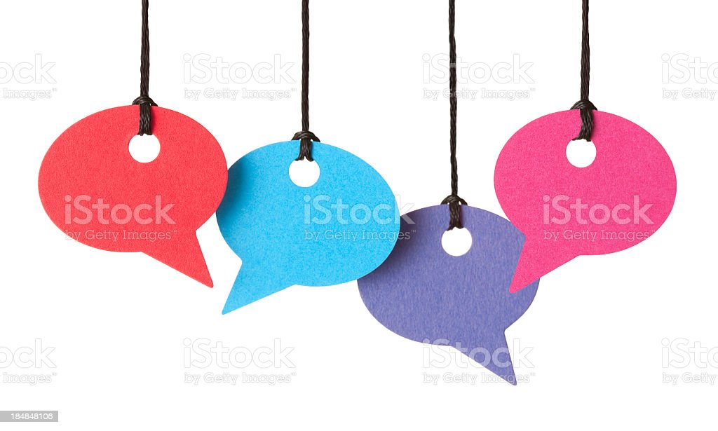 Four blank speech bubbles hanging from thread royalty-free stock photo