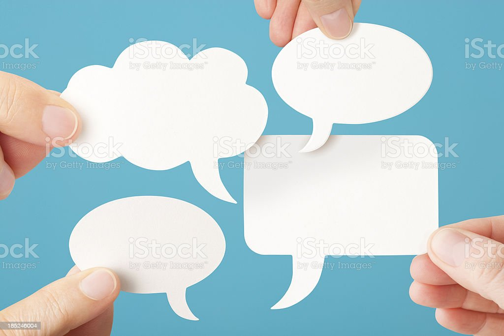 Four blank white conversation speech bubbles stock photo