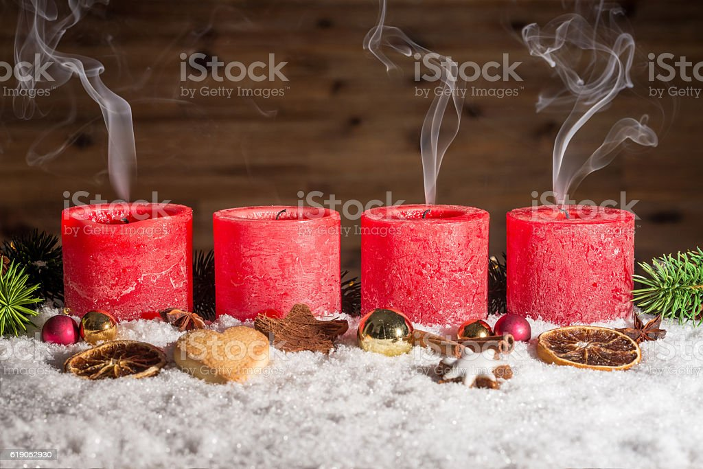 Four blown out advent candles with space in snow stock photo