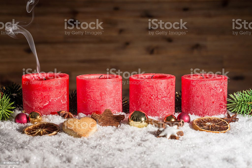 Four blown out advent candles with space stock photo