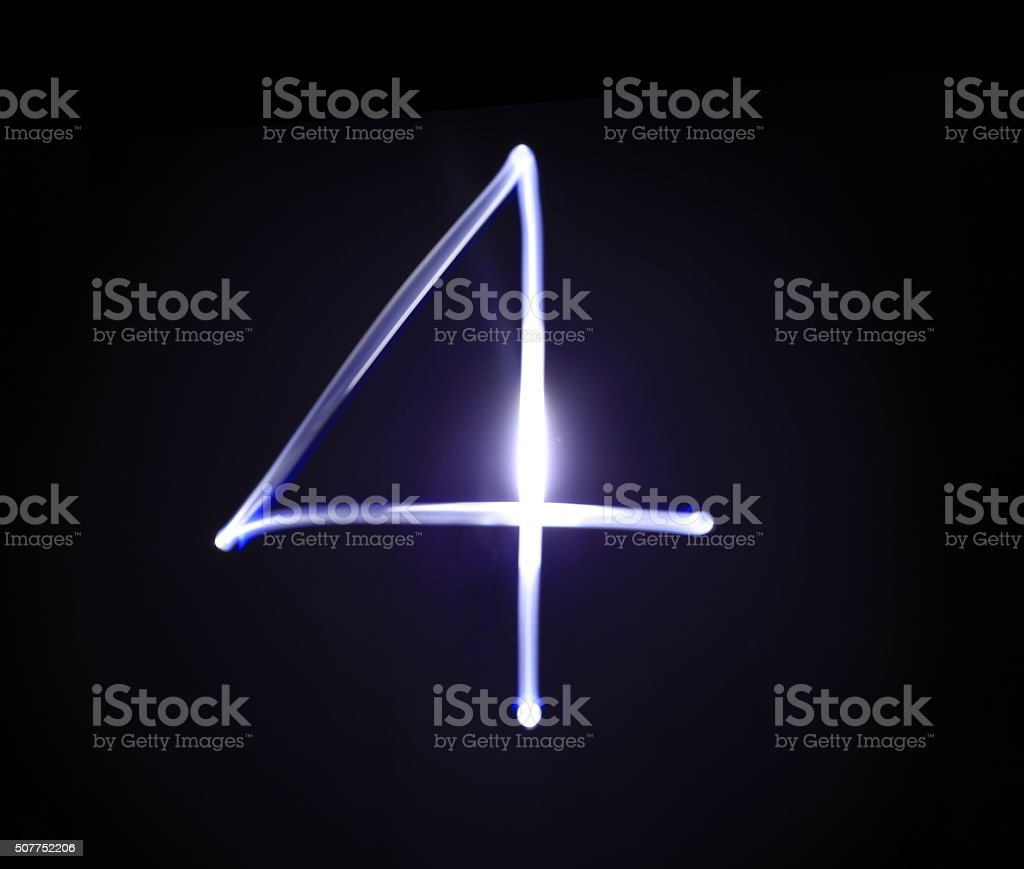 Four blue light digit hand writing over black background. stock photo