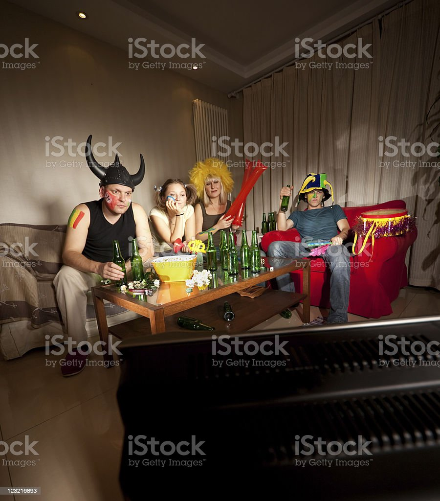 Four bored fans stock photo