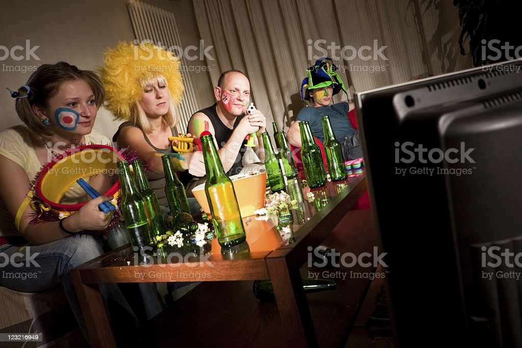 Four bored fans royalty-free stock photo