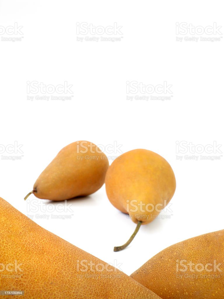 Four Bosc Pears, detail. stock photo
