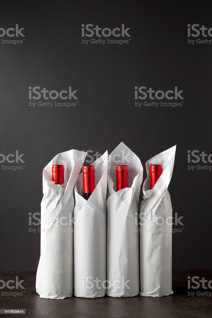 Four bottles on black stock photo