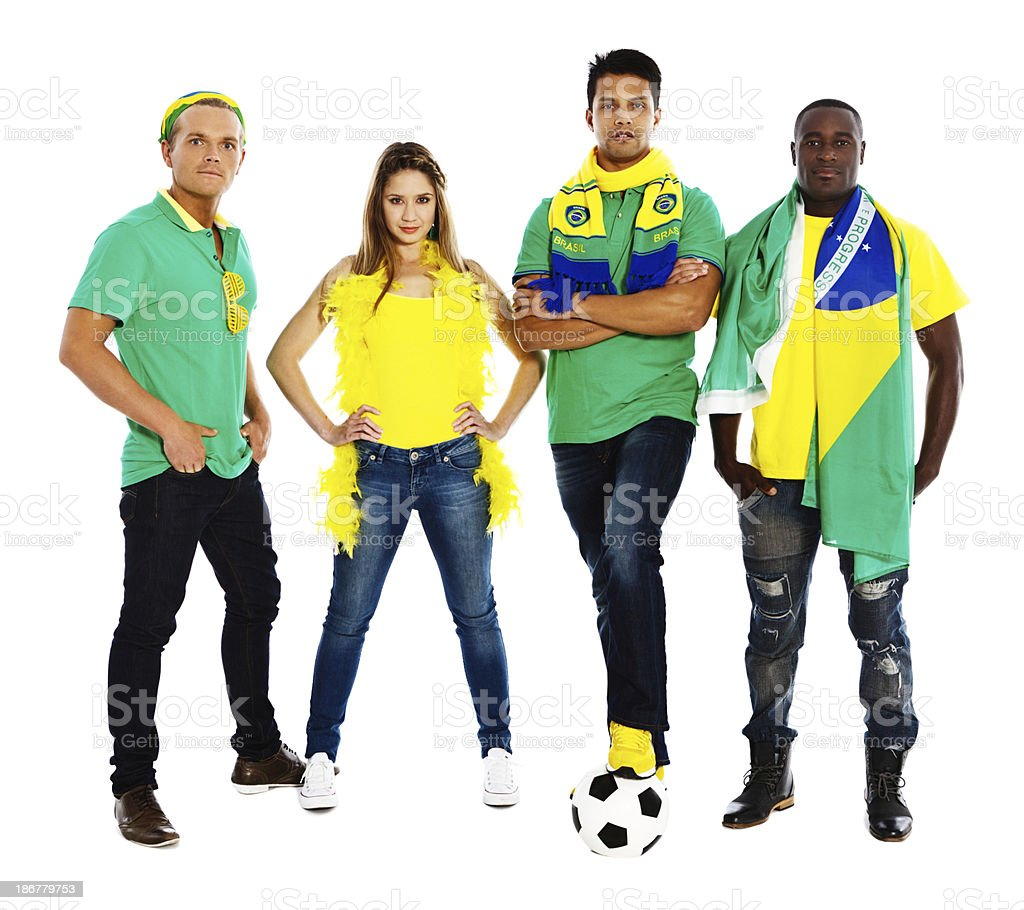Four Brazilian soccer fans take on the world! royalty-free stock photo