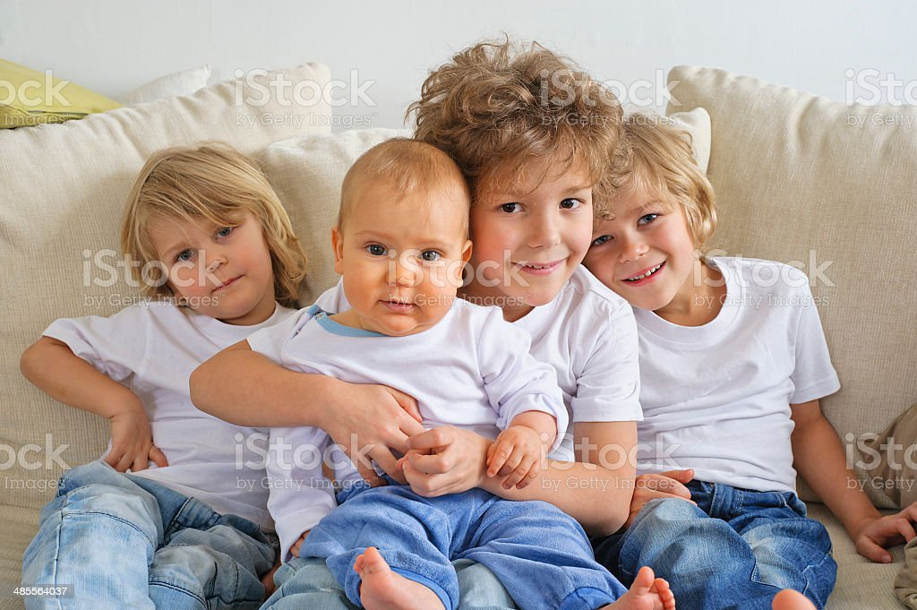 Four brothers on a couch stock photo
