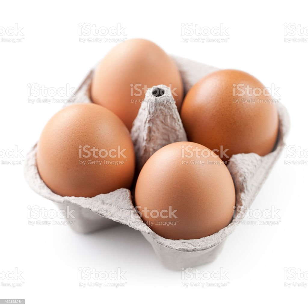 Four brown eggs in carton stock photo