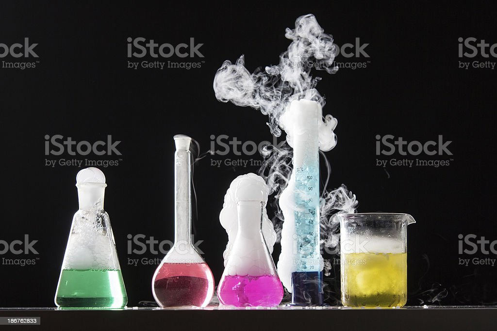 Four bubbling beakers of colorful liquid royalty-free stock photo