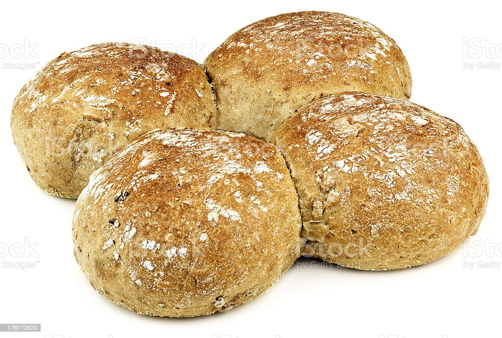 four buns with a bit of flour on them royalty-free stock photo