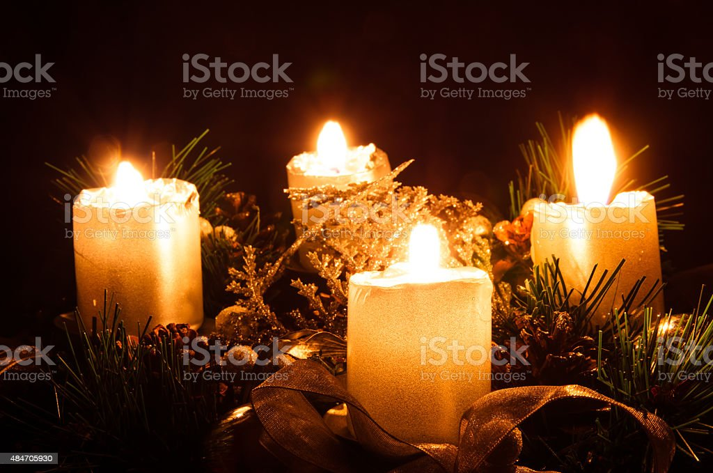 four burning candles stock photo