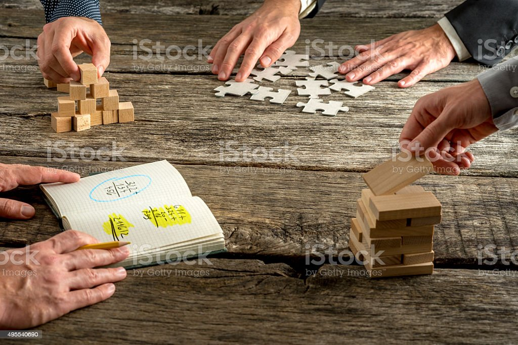 Four business people brainstorming searching for innovative idea stock photo