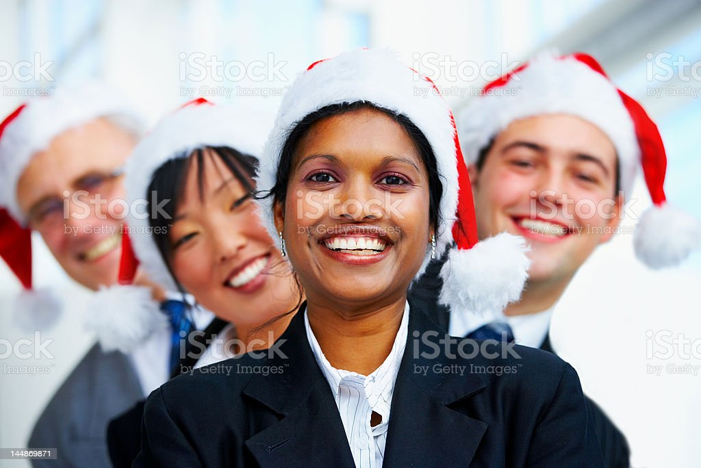 Four business people celebrating christmas in the office royalty-free stock photo