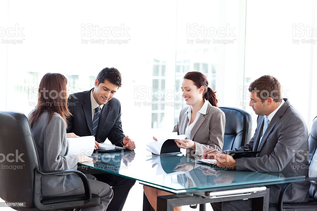 Four business people during a meeting royalty-free stock photo