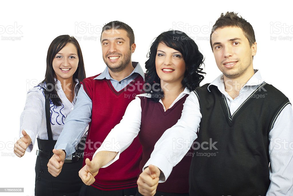 Four business people giving thumbs royalty-free stock photo