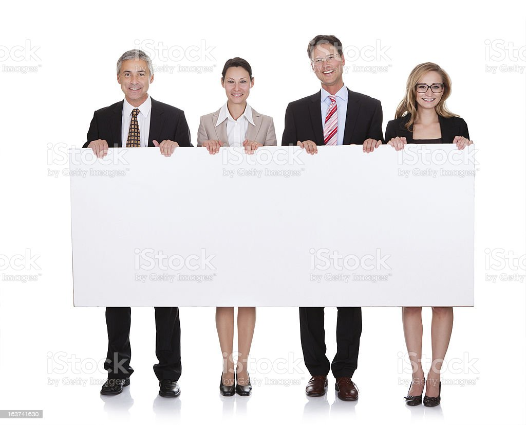 Four business people holding a blank white banner stock photo
