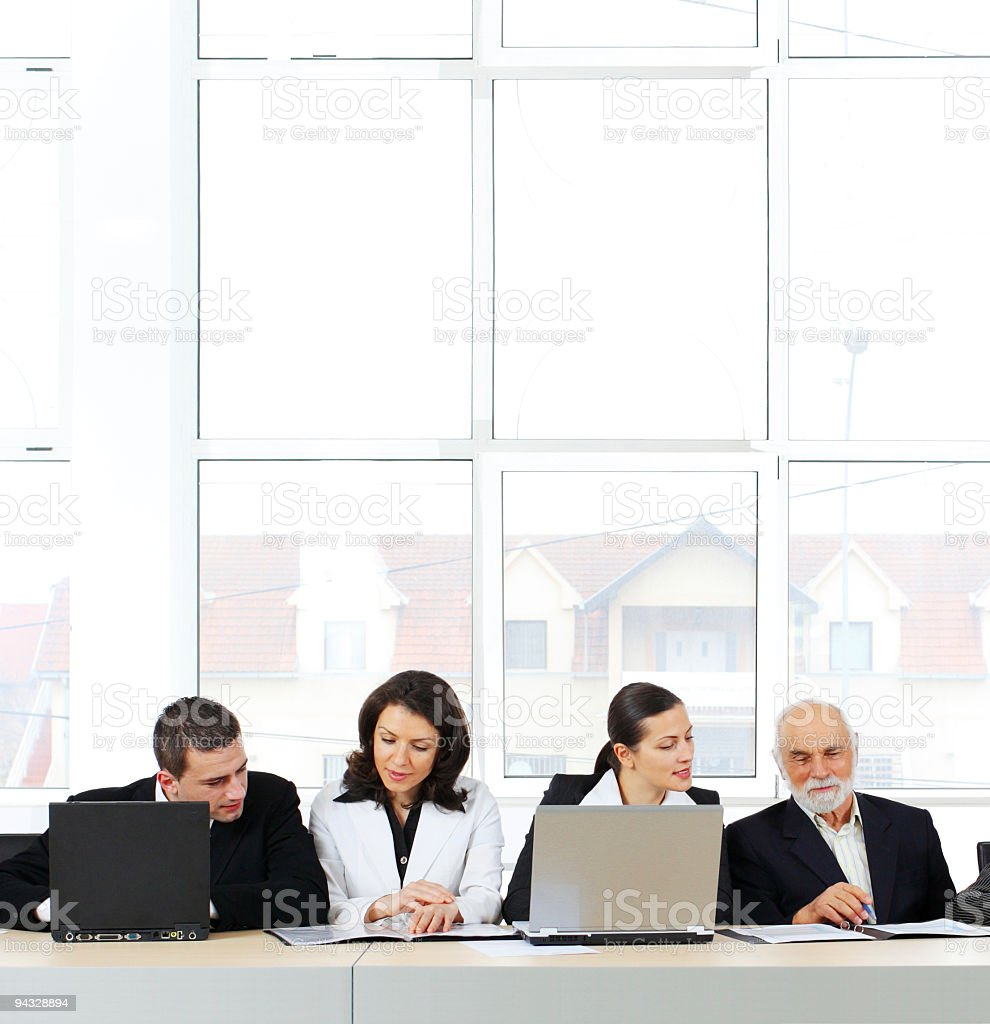Four business people on conference. royalty-free stock photo