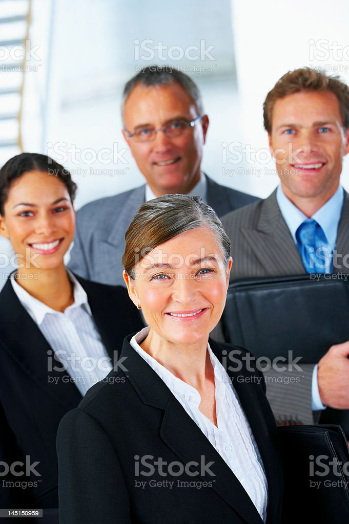 Four business people smiling royalty-free stock photo