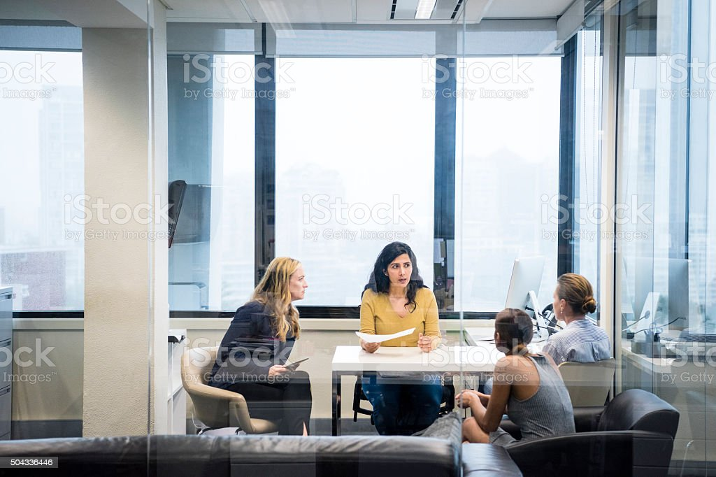 Four business women having meeting in modern office stock photo