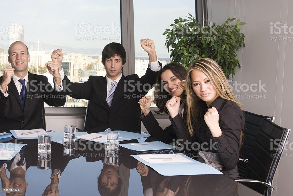 Four businesspeople celebrating royalty-free stock photo