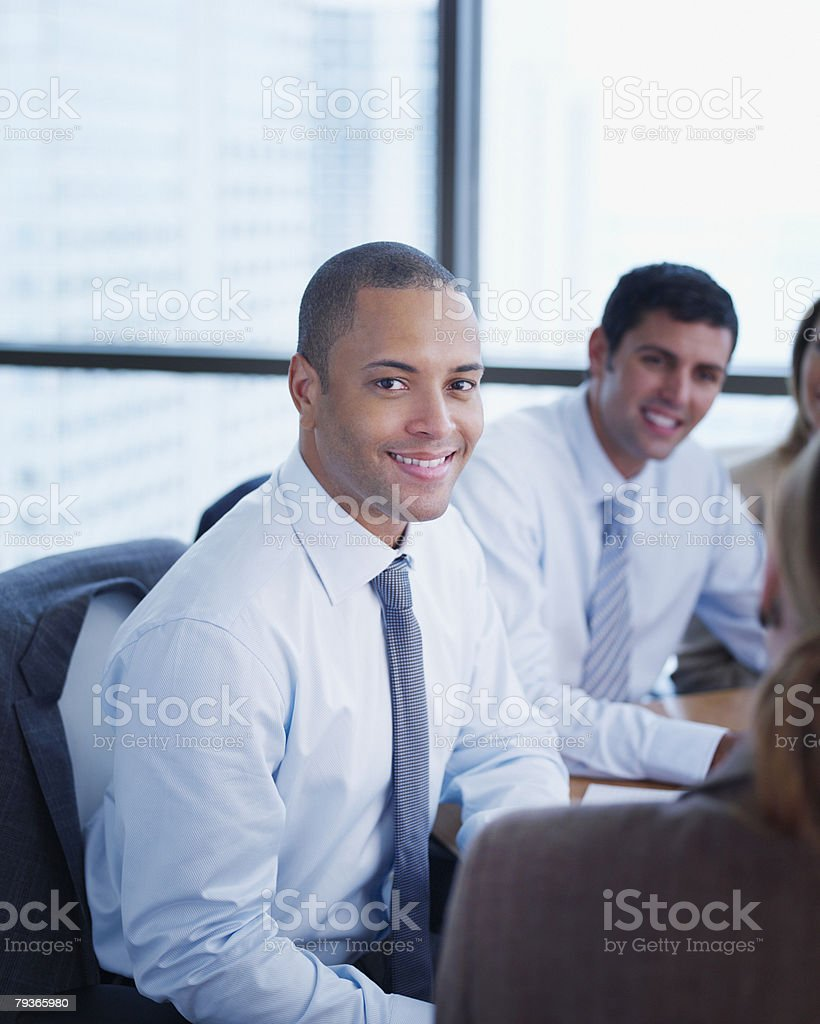 Four businesspeople in boardroom royalty-free stock photo