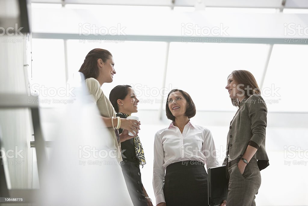 Four businesswomen in a meeting at office lobby royalty-free stock photo