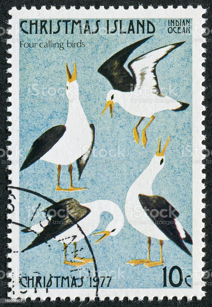 Four Calling Birds Stamp stock photo