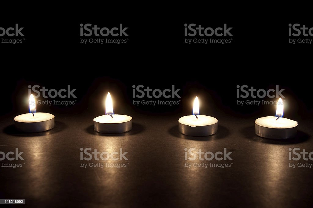 Four Candles On Black royalty-free stock photo