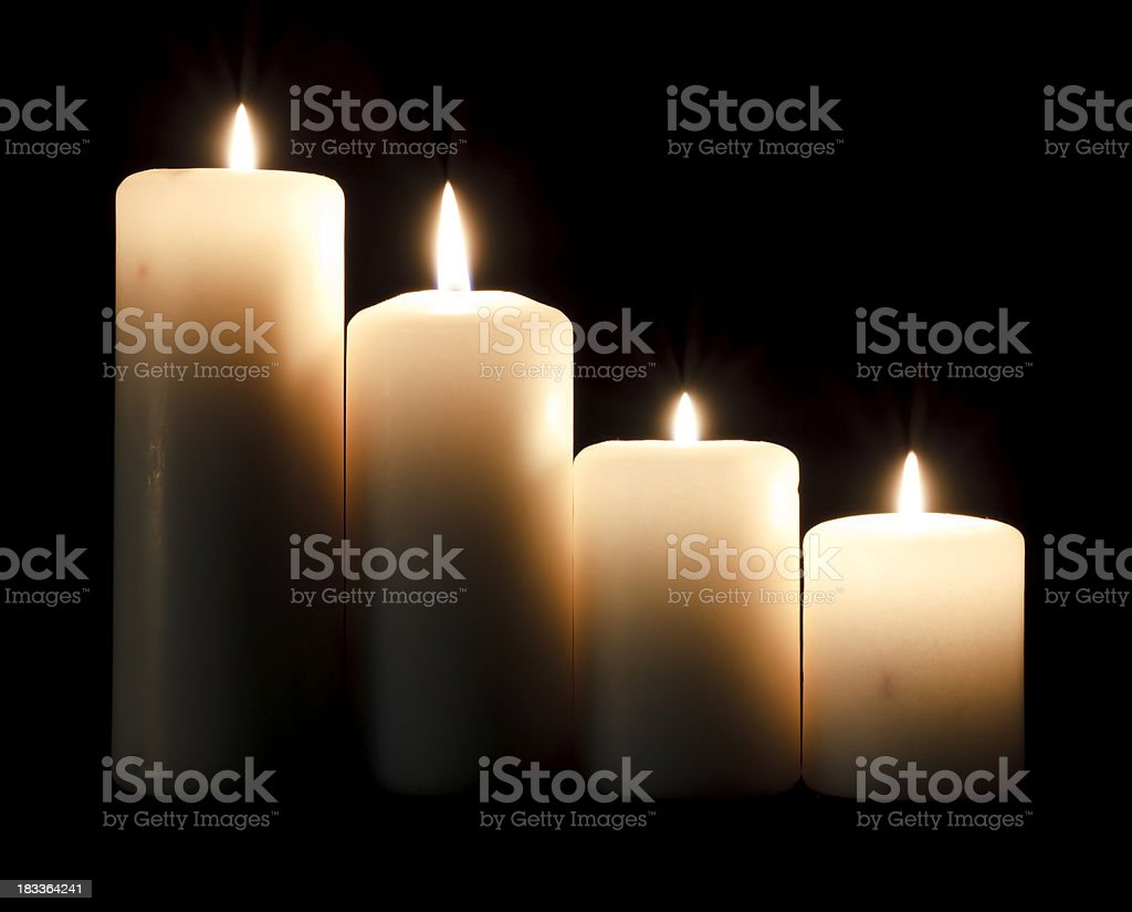 Four candles stock photo