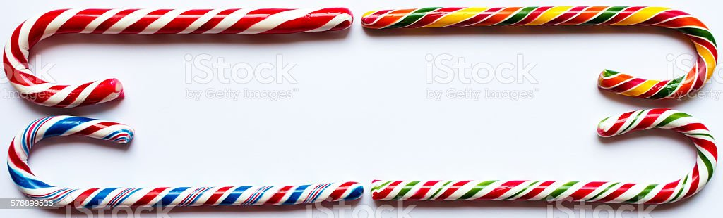 Four candy canes building a frame. stock photo