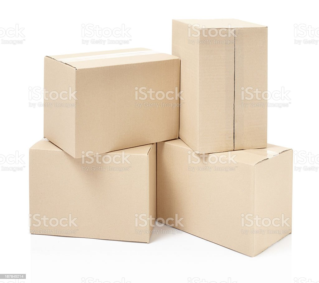 Four cardboard boxes stacked with a white background royalty-free stock photo