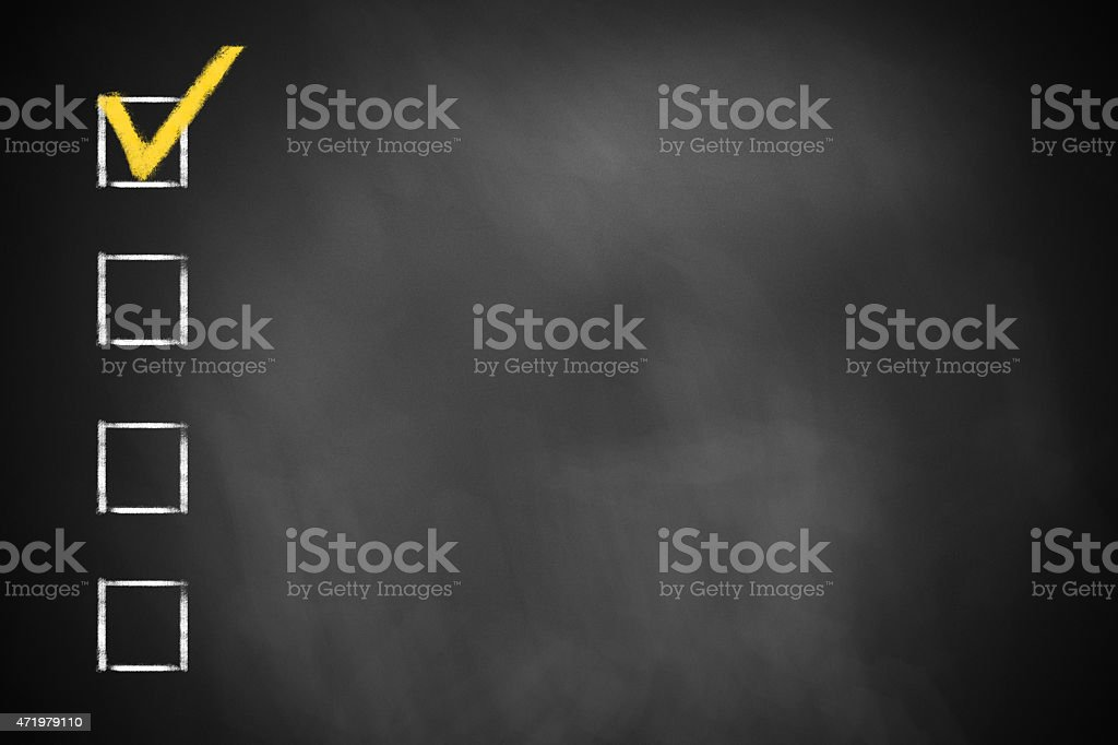 four checkboxes on a black chalkboard stock photo
