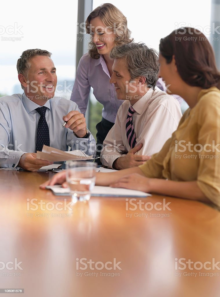 Four cheerful executives at a business meeting in office royalty-free stock photo