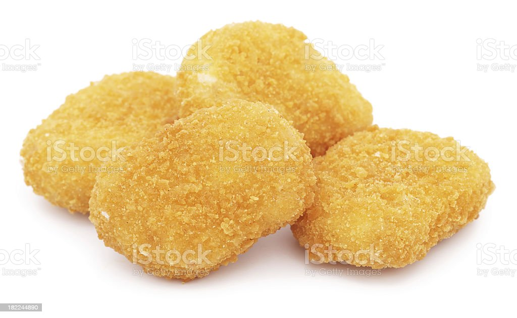 Four chicken nuggets isolated on white stock photo