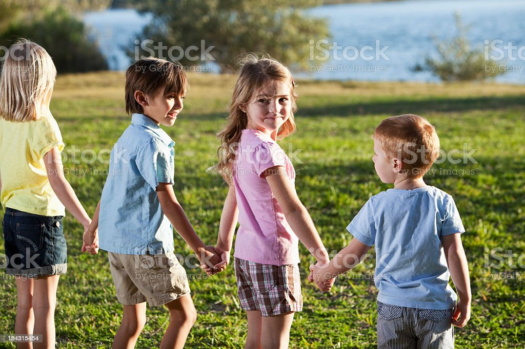 Four children at the park royalty-free stock photo