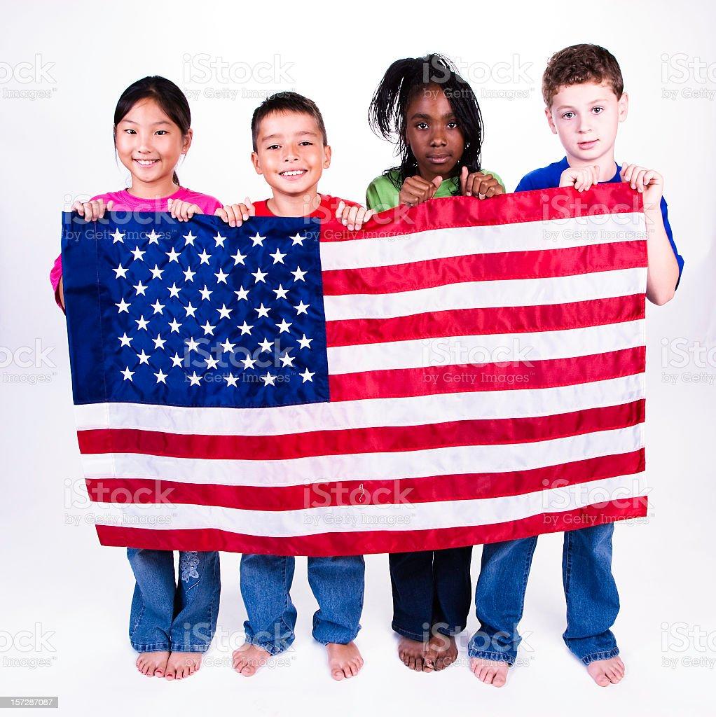 Four children holding the United States flag stock photo
