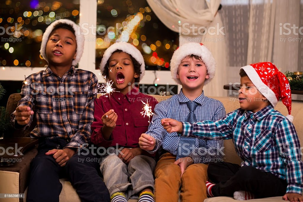 Four children sing Christmas song. stock photo