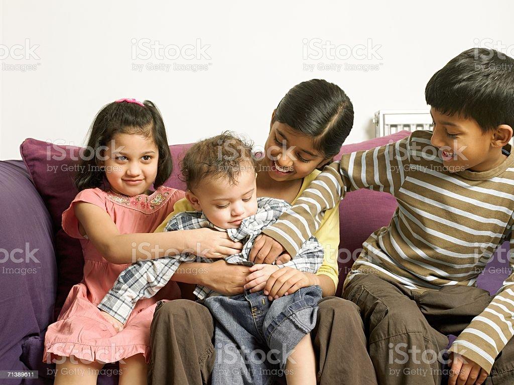 Four children sitting on sofa royalty-free stock photo