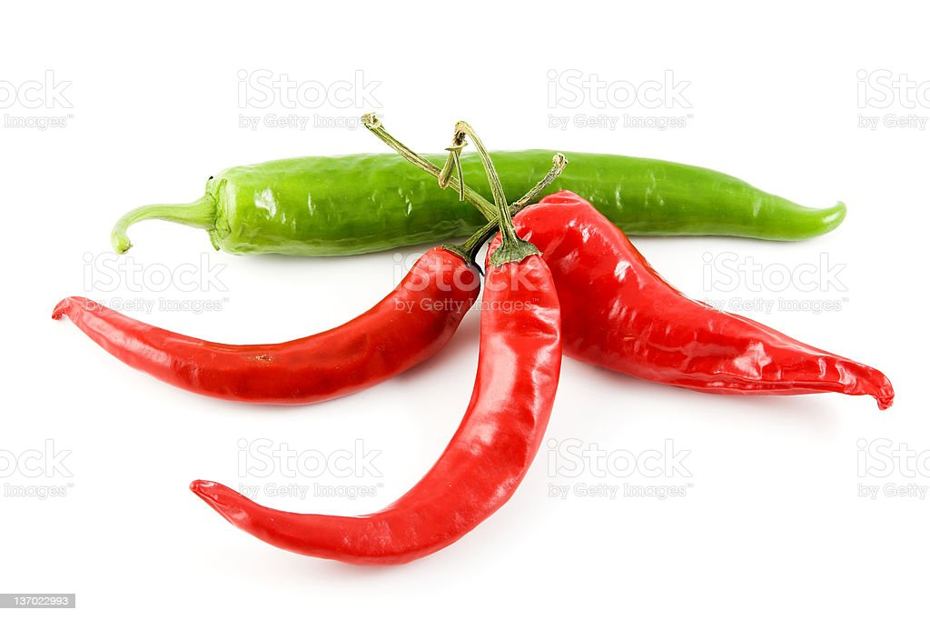 Four chilli peppers royalty-free stock photo