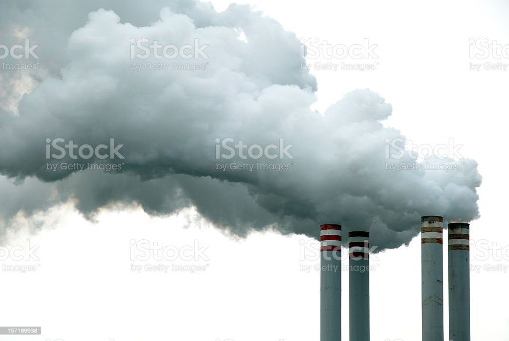 Four Chimneys and Smoke stock photo