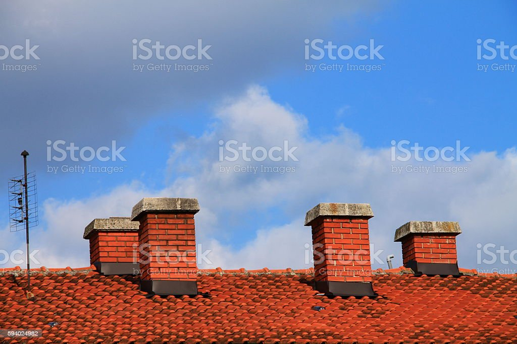 Four chimneys on the roof of the house stock photo