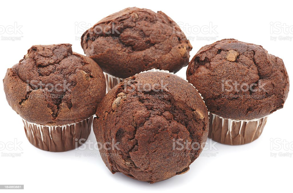 Four chocolate muffins isolated on white royalty-free stock photo