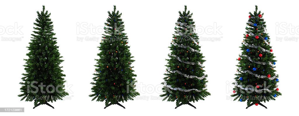 Four Christmas Trees Showing Different Stages of the Decorating Process stock photo
