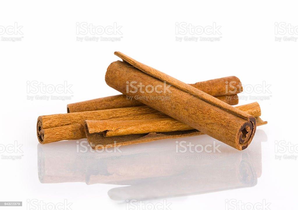Four cinnamon sticks on a white background royalty-free stock photo