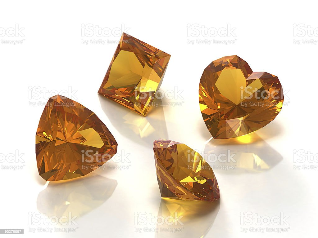 Four citrine gemstones of different cuts isolated on white royalty-free stock photo