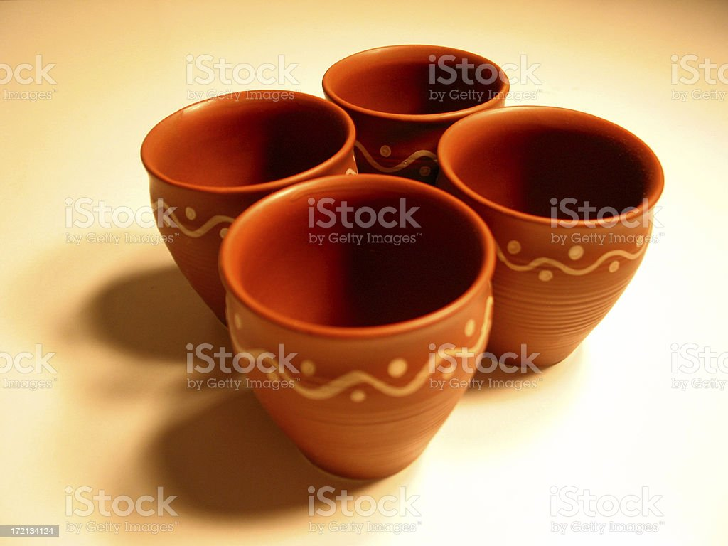 Four Clay Pottery Cups stock photo
