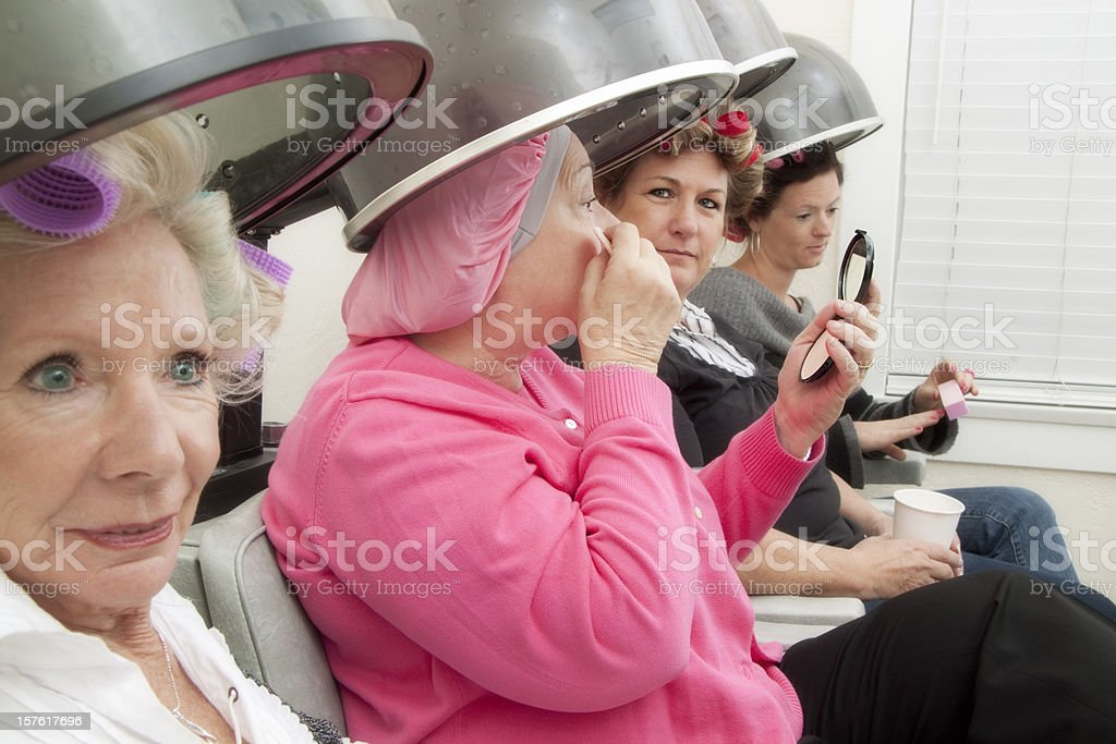 Four clients at a beauty salon royalty-free stock photo