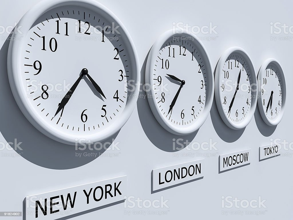 Four clocks with different time zones stock photo