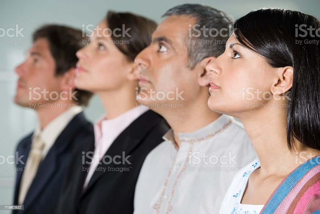Four colleagues looking up stock photo