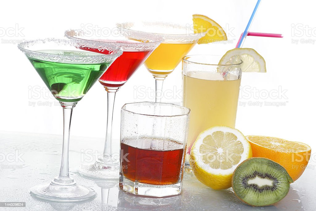 four colored cocktails, whisky and fruit royalty-free stock photo